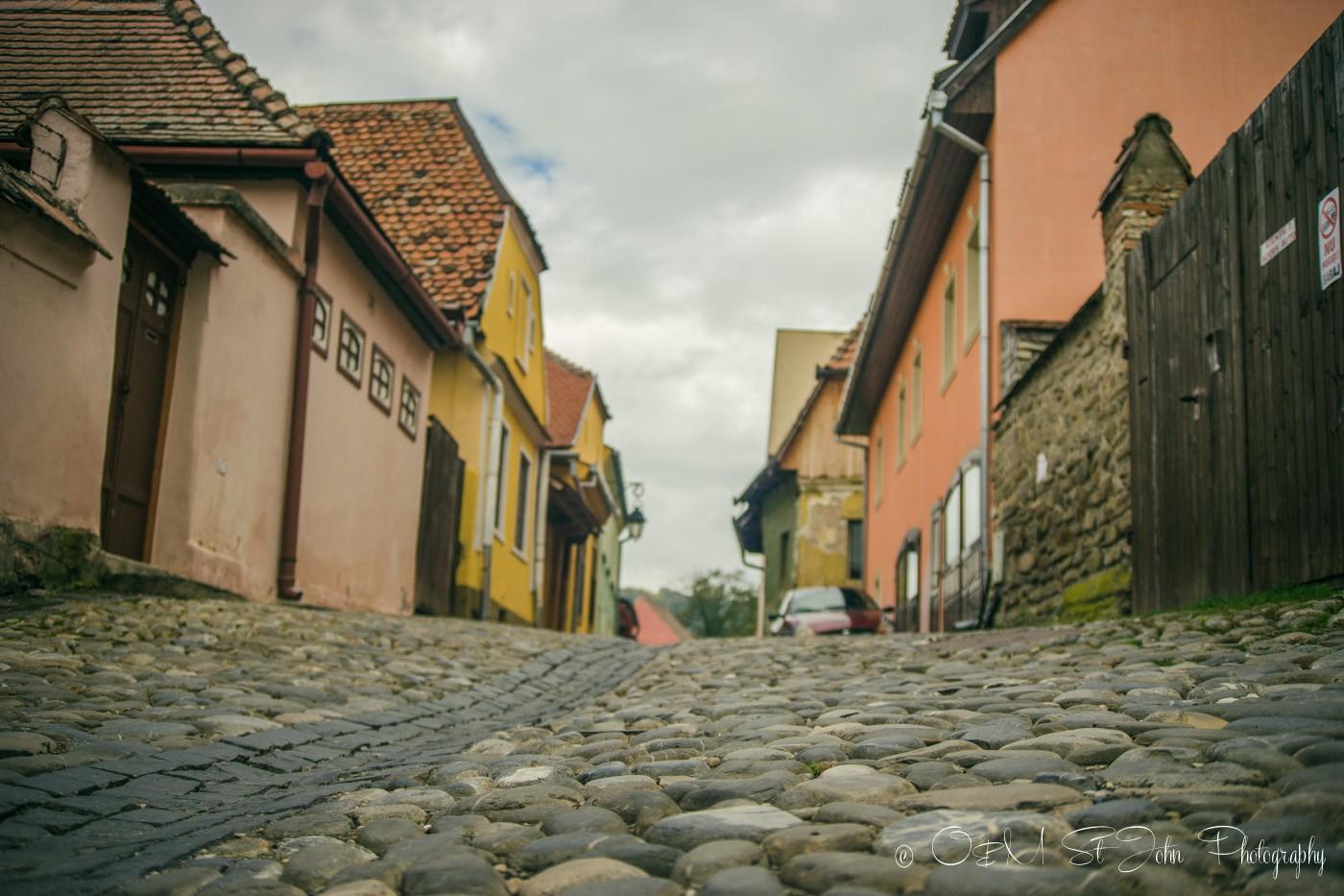 Cobblestone street in Sighisoara, Romania