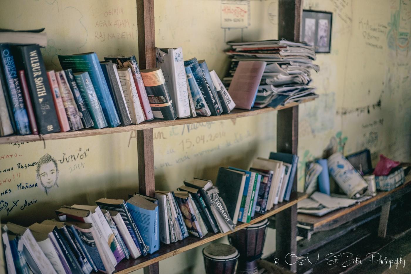 Books in common room at Mañana Borneo Resort. Sabah. Malaysia