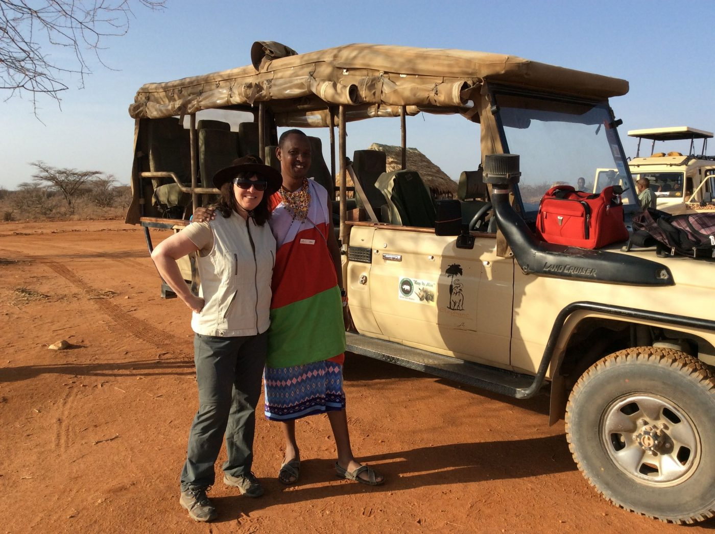 Safari Lodges in Kenya: Shannon (author) with Msasai Guide ready for a Safari
