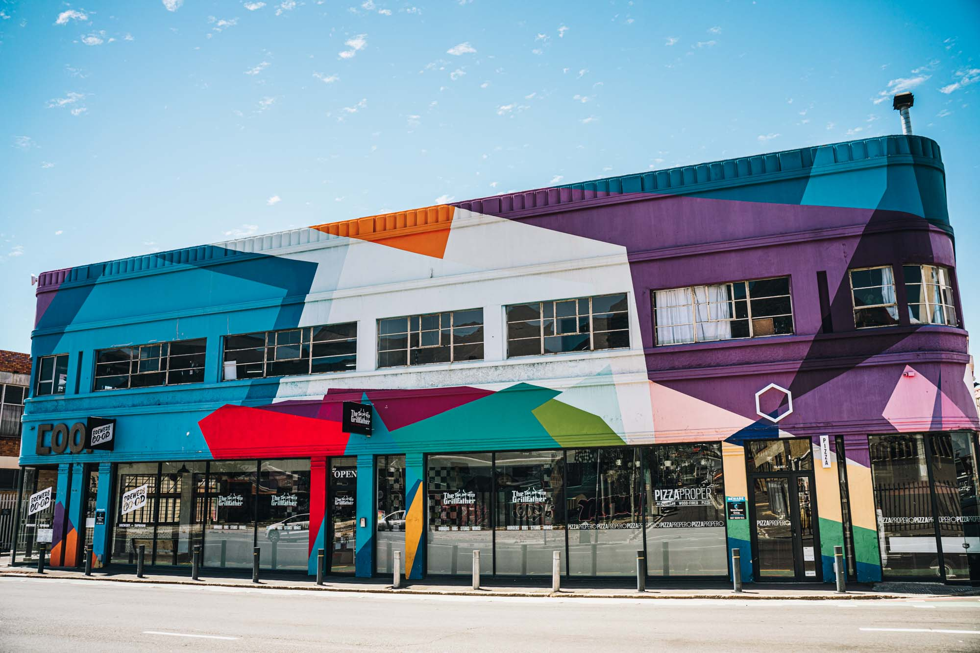 One of the many graffiti coloured buildings in Woodstock, Cape Town