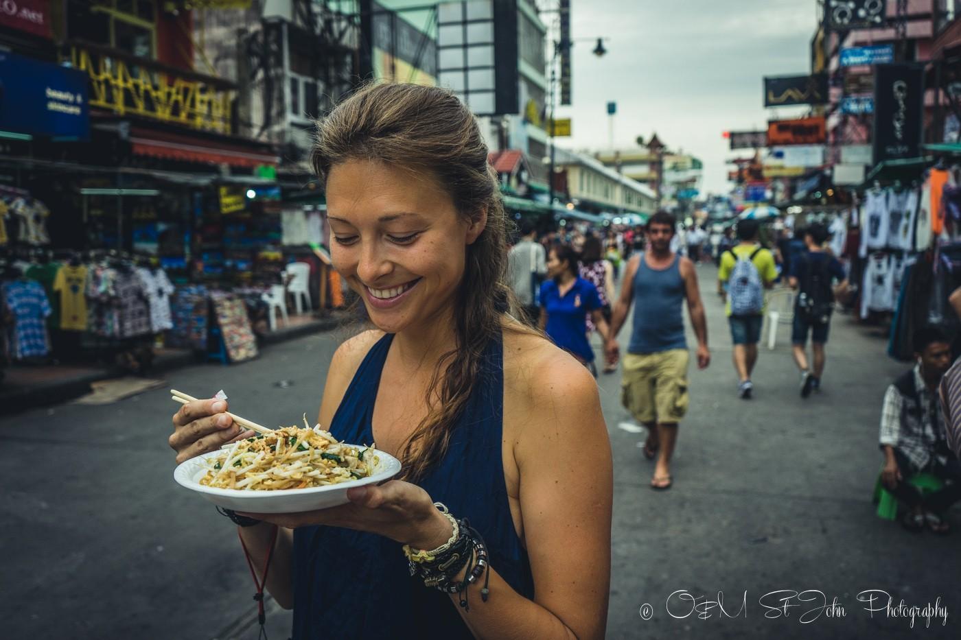 Enjoying a pad thai on Khao San Road in Bangkok. Thailand