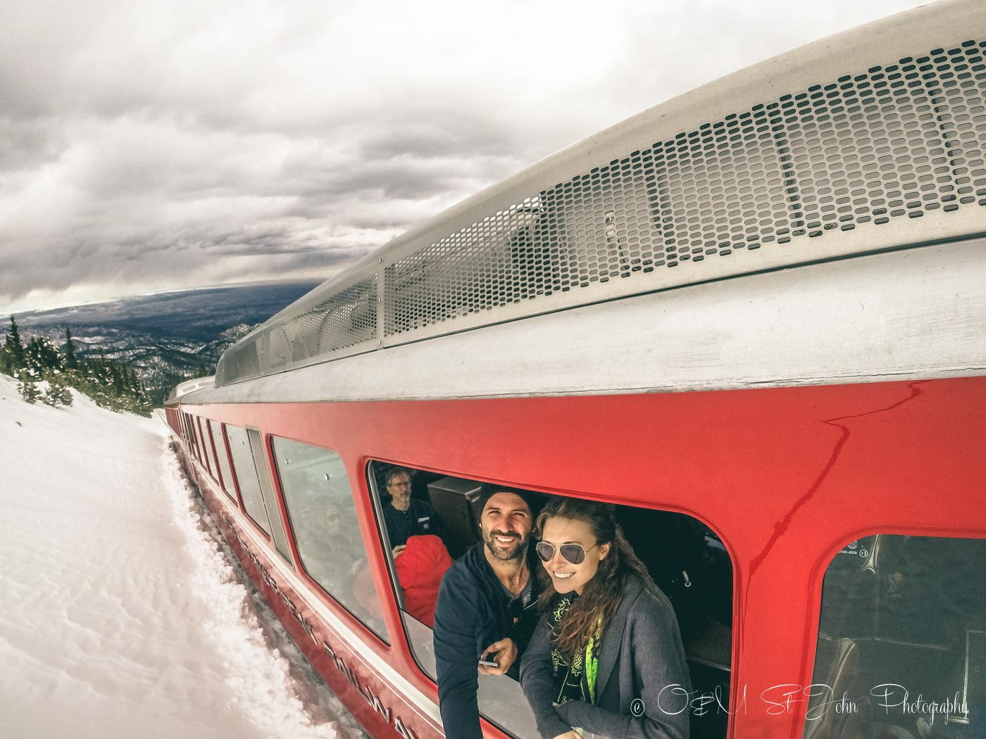 Road trip USA: Max & Oksana peaking out of Cog Railway en route to the top of Pikes Peak. Rocky Mountains. Colorado. USA Road trip
