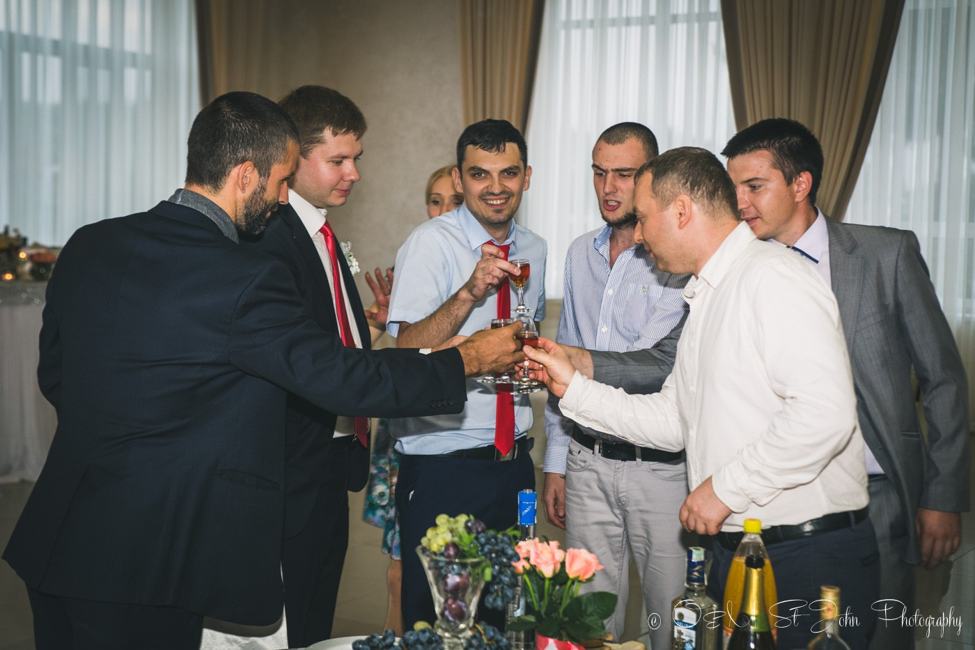 Men drinking at my cousin's wedding in Ukraine