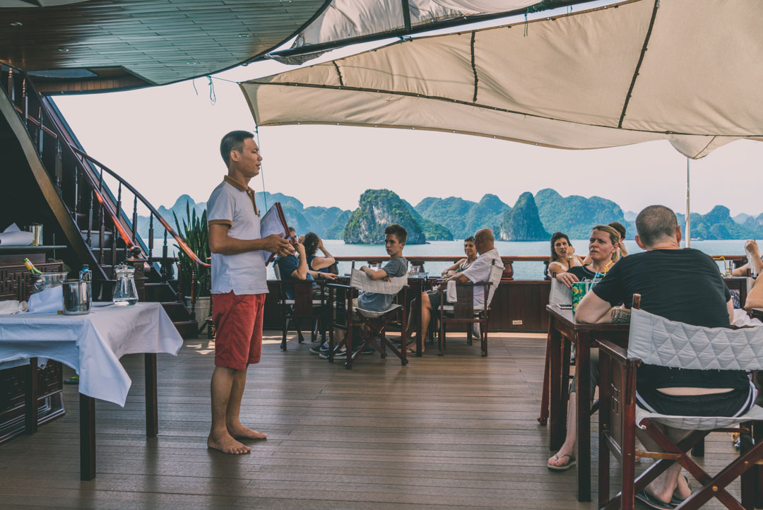 Halong Bay Cruise: Tour guide, Kenny, conducting a briefing on deck