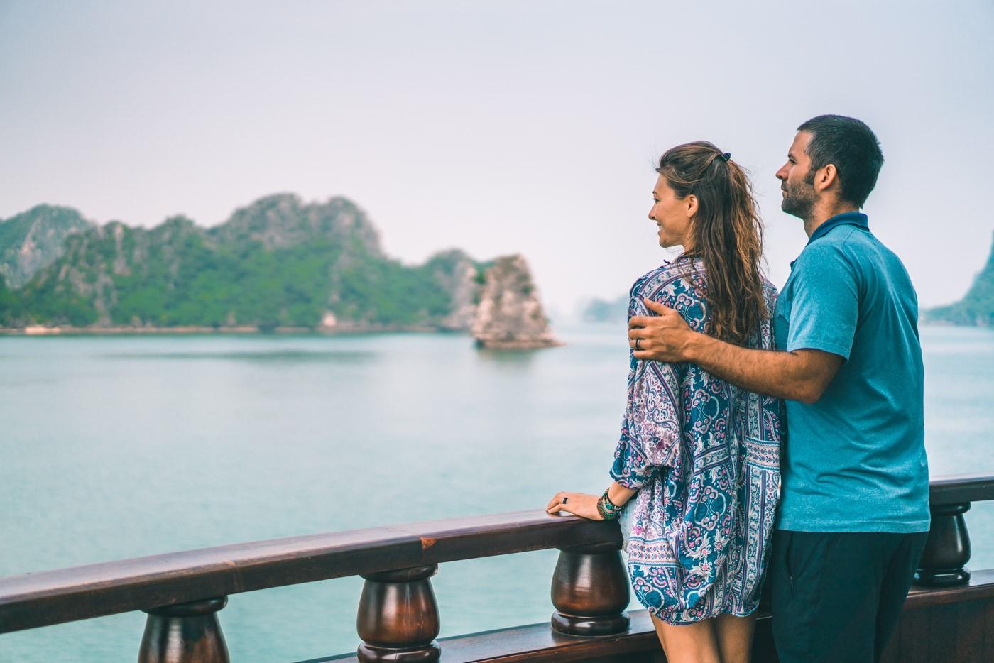Halong Bay Cruise: Oksana & Max enjoying the scenery of Bai Tu Long Bay on Dragon Legend Cruise
