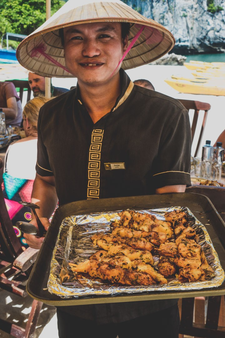 Thomas, serving us delicious sea food during BBQ lunch on a beach in Bai Tu Long Bay