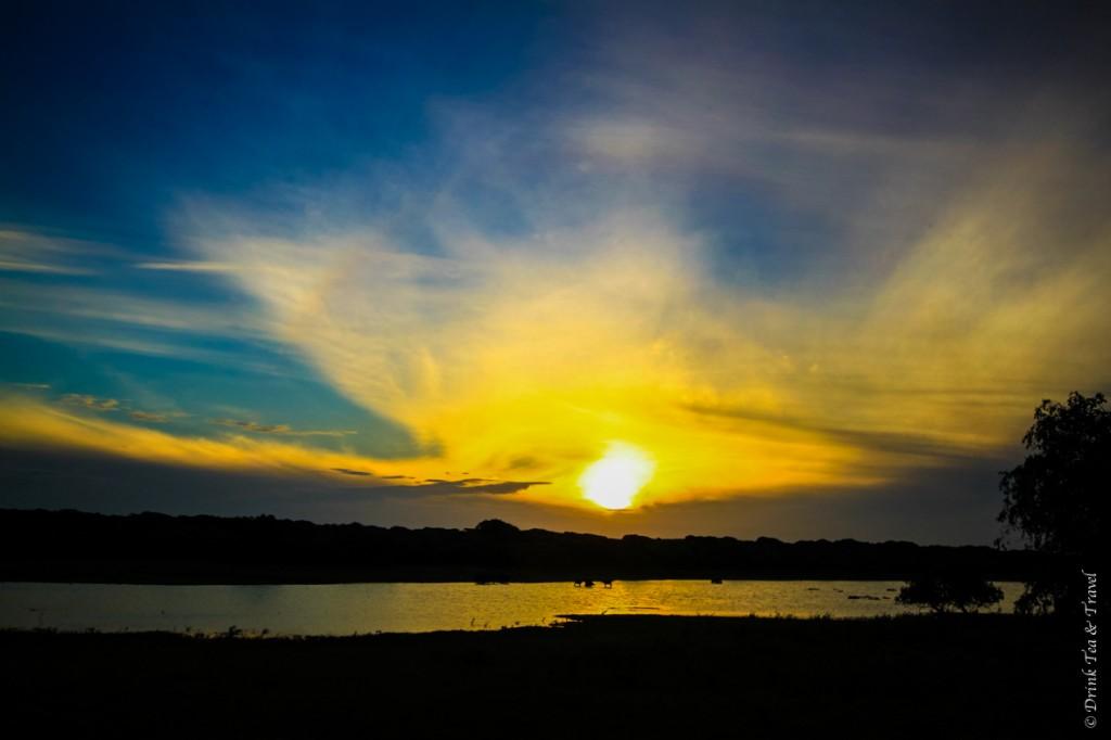 Sun rises over a lagoon in Yala National Park, Sri Lanka