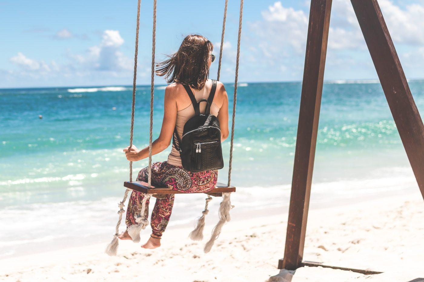 Minimalism: swinging on the beach