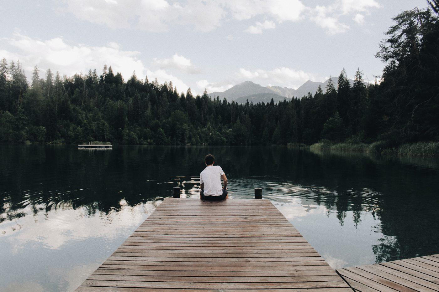 Minimalism: man sitting on dock