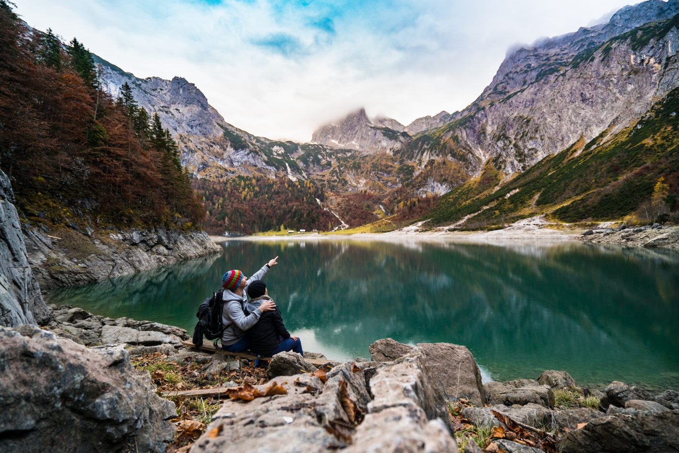 me time during a couples trip: two people at the lake enjoying the mountains