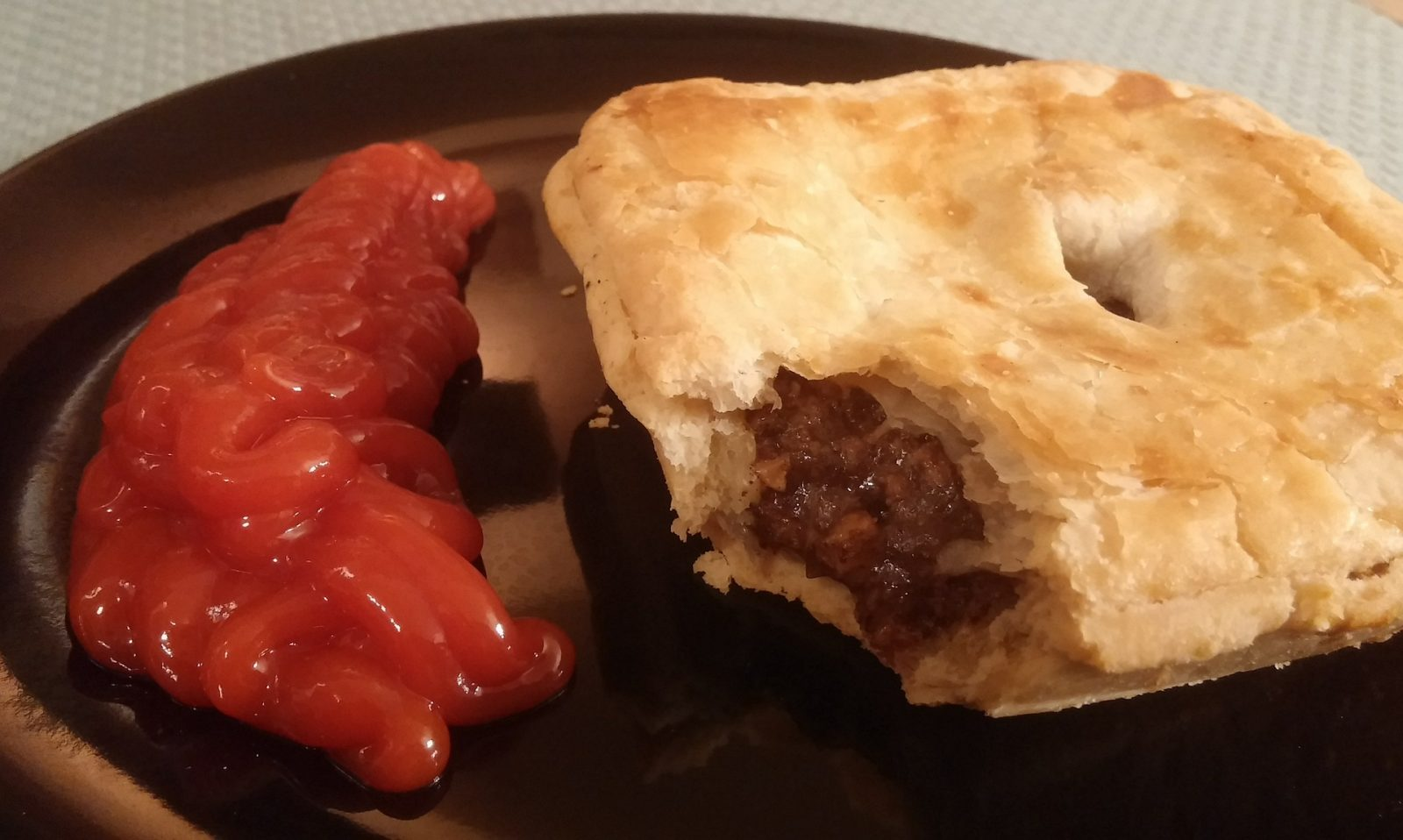 Food to try in Australia: A classic Australian mince meat pie with tomato sauce