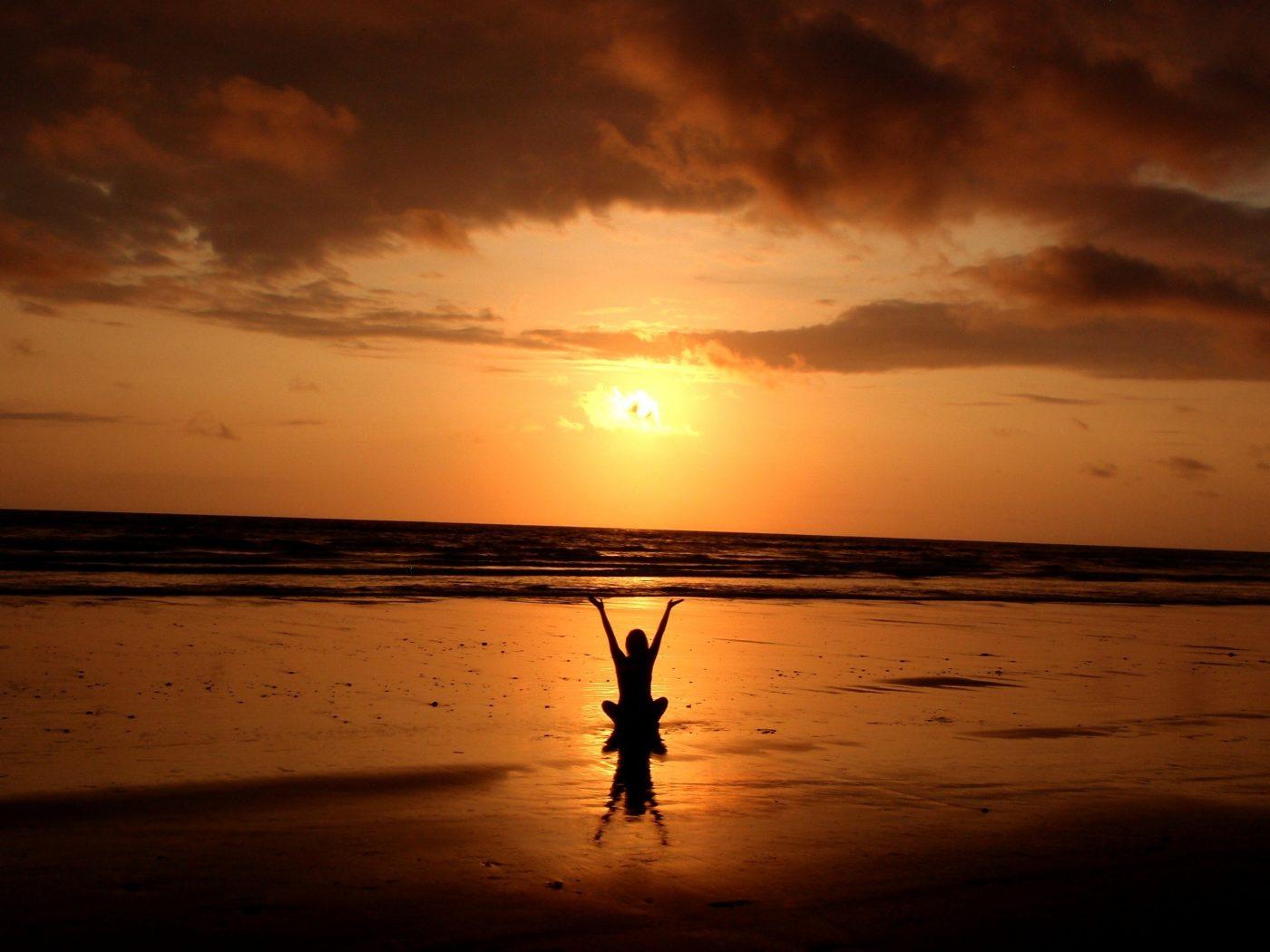 Minimalism: person enjoying the sunset at the beach