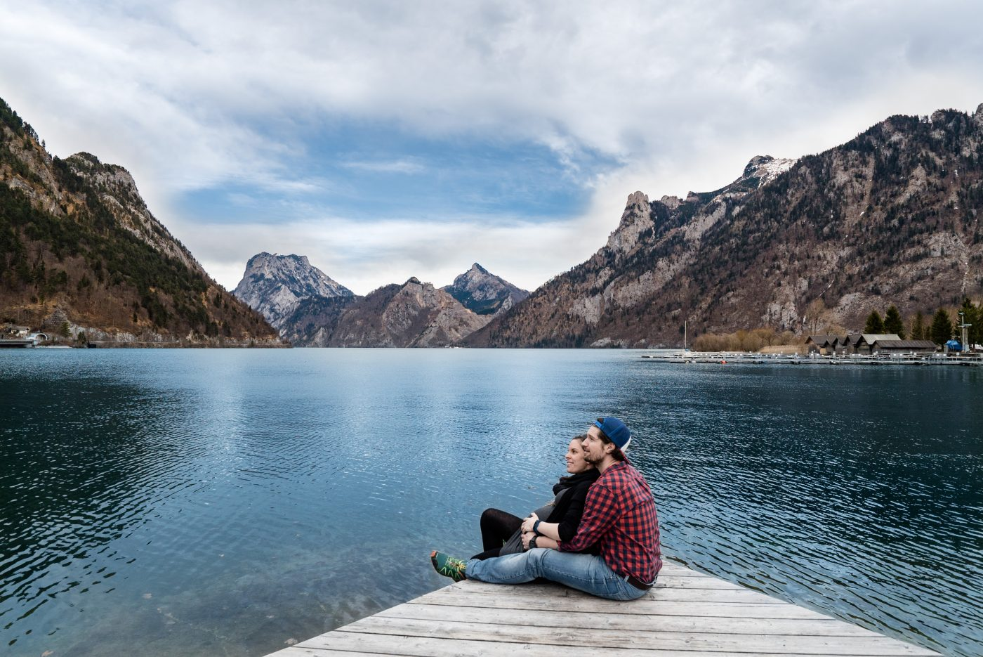 romance travel: sitting on a dock of the lake