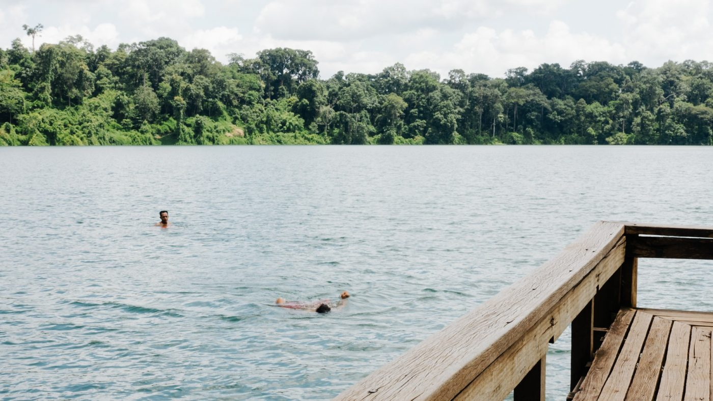Staying Fit While Traveling: swimming in the lake