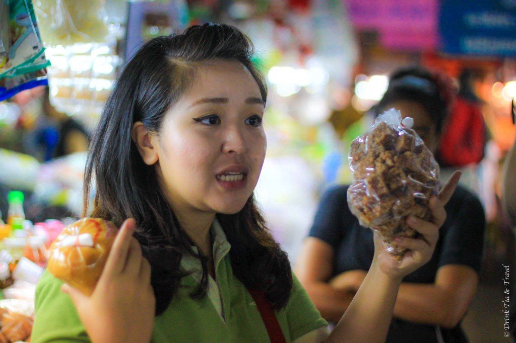 Thai Farm Cooking Class: our guide shares her shopping tips at Ruamchook Market, Chiang Mai, Thailand